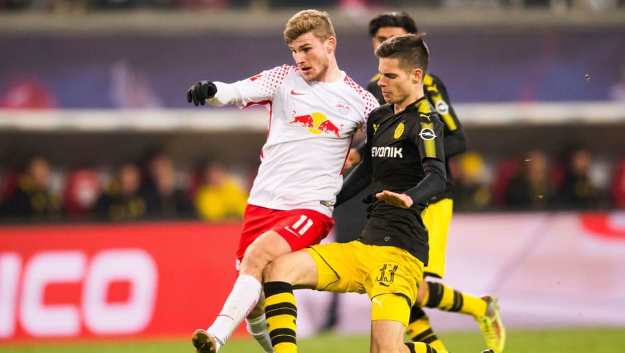 Leipzig´s forward Timo Werner (L) and Dortmund´s midfielder Julian Weigl vie for the ball during the German first division Bundesliga football match RB Leipzig vs Borussia Dortmund in Leipzig, eastern Germany, on March 3, 2018. / AFP PHOTO / ROBERT MICHAEL / RESTRICTIONS: DURING MATCH TIME: DFL RULES TO LIMIT THE ONLINE USAGE TO 15 PICTURES PER MATCH AND FORBID IMAGE SEQUENCES TO SIMULATE VIDEO. == RESTRICTED TO EDITORIAL USE == FOR FURTHER QUERIES PLEASE CONTACT DFL DIRECTLY AT + 49 69 650050         (Photo credit should read ROBERT MICHAEL/AFP/Getty Images)