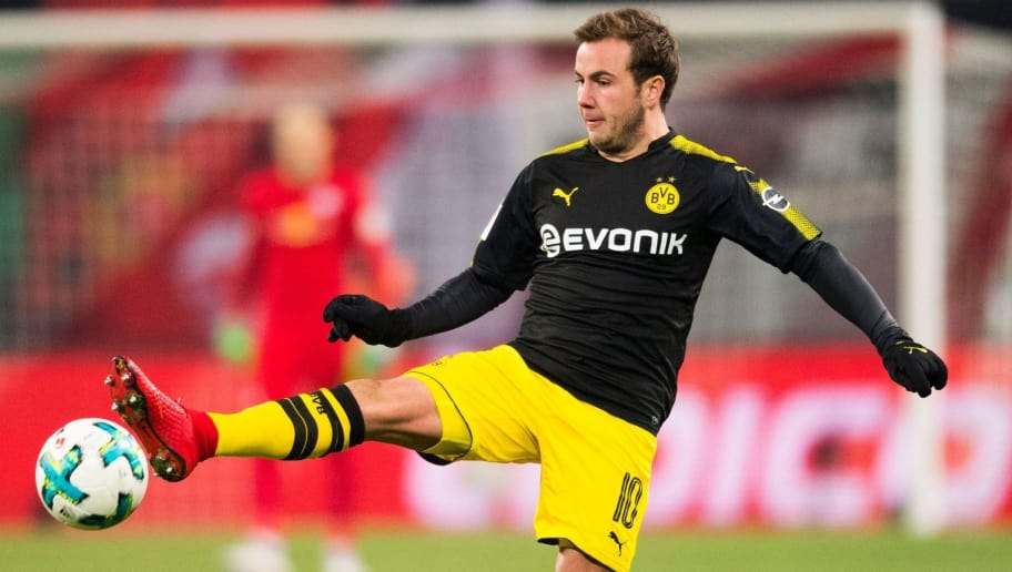Dortmund's German midfielder Mario Goetze plays the ball during the German first division Bundesliga football match RB Leipzig vs Borussia Dortmund in Leipzig, eastern Germany, on March 3, 2018. / AFP PHOTO / ROBERT MICHAEL / RESTRICTIONS: DURING MATCH TIME: DFL RULES TO LIMIT THE ONLINE USAGE TO 15 PICTURES PER MATCH AND FORBID IMAGE SEQUENCES TO SIMULATE VIDEO. == RESTRICTED TO EDITORIAL USE == FOR FURTHER QUERIES PLEASE CONTACT DFL DIRECTLY AT + 49 69 650050         (Photo credit should read ROBERT MICHAEL/AFP/Getty Images)