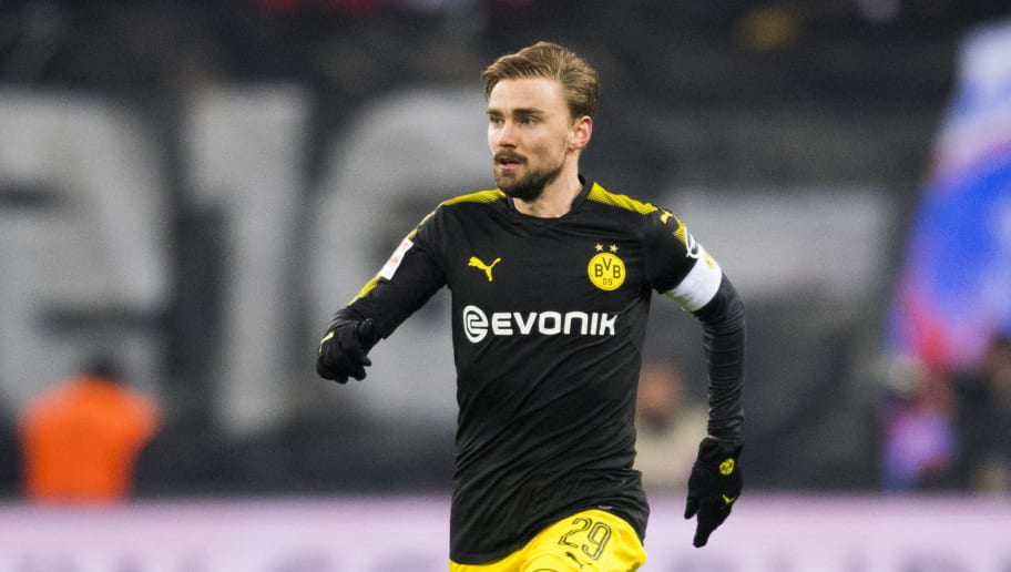 Dortmund's German defender Marcel Schmelzer plays the ball during the German first division Bundesliga football match RB Leipzig vs Borussia Dortmund in Leipzig, eastern Germany, on March 3, 2018. / AFP PHOTO / ROBERT MICHAEL / RESTRICTIONS: DURING MATCH TIME: DFL RULES TO LIMIT THE ONLINE USAGE TO 15 PICTURES PER MATCH AND FORBID IMAGE SEQUENCES TO SIMULATE VIDEO. == RESTRICTED TO EDITORIAL USE == FOR FURTHER QUERIES PLEASE CONTACT DFL DIRECTLY AT + 49 69 650050         (Photo credit should read ROBERT MICHAEL/AFP/Getty Images)