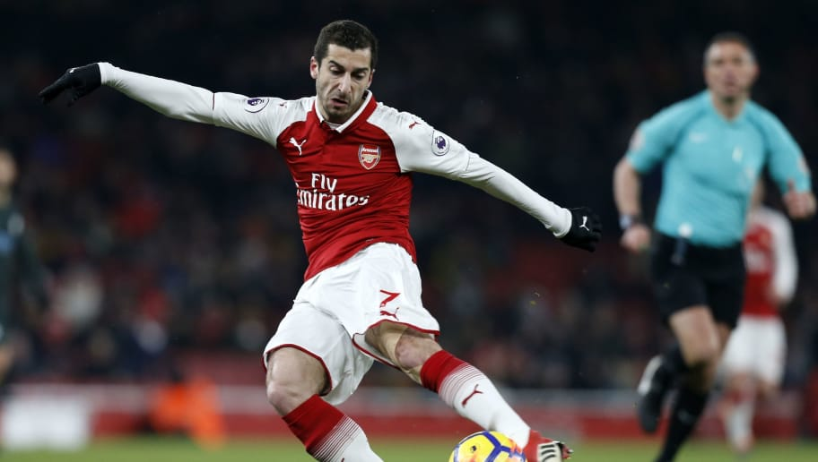Arsenal's Armenian midfielder Henrikh Mkhitaryan has an unsuccessful shot during the English Premier League football match between Arsenal and Manchester City at the Emirates Stadium in London on March 1, 2018.  / AFP PHOTO / IKIMAGES / Ian KINGTON / RESTRICTED TO EDITORIAL USE. No use with unauthorized audio, video, data, fixture lists, club/league logos or 'live' services. Online in-match use limited to 45 images, no video emulation. No use in betting, games or single club/league/player publications.  /         (Photo credit should read IAN KINGTON/AFP/Getty Images)