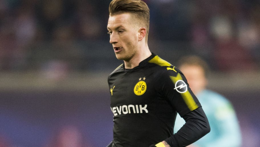 Dortmund's German forward Marco Reus plays the ball during the German first division Bundesliga football match RB Leipzig vs Borussia Dortmund in Leipzig, eastern Germany, on March 3, 2018. / AFP PHOTO / ROBERT MICHAEL / RESTRICTIONS: DURING MATCH TIME: DFL RULES TO LIMIT THE ONLINE USAGE TO 15 PICTURES PER MATCH AND FORBID IMAGE SEQUENCES TO SIMULATE VIDEO. == RESTRICTED TO EDITORIAL USE == FOR FURTHER QUERIES PLEASE CONTACT DFL DIRECTLY AT + 49 69 650050         (Photo credit should read ROBERT MICHAEL/AFP/Getty Images)