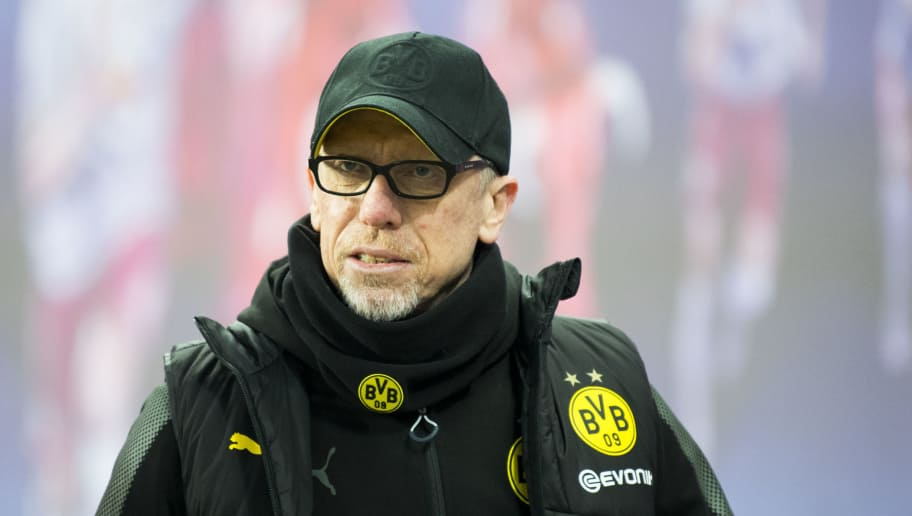 Dortmund´s Austrian head coach Peter Stoeger looks on prior to the German first division Bundesliga football match RB Leipzig vs Borussia Dortmund in Leipzig, eastern Germany, on March 3, 2018. / AFP PHOTO / ROBERT MICHAEL / RESTRICTIONS: DURING MATCH TIME: DFL RULES TO LIMIT THE ONLINE USAGE TO 15 PICTURES PER MATCH AND FORBID IMAGE SEQUENCES TO SIMULATE VIDEO. == RESTRICTED TO EDITORIAL USE == FOR FURTHER QUERIES PLEASE CONTACT DFL DIRECTLY AT + 49 69 650050         (Photo credit should read ROBERT MICHAEL/AFP/Getty Images)