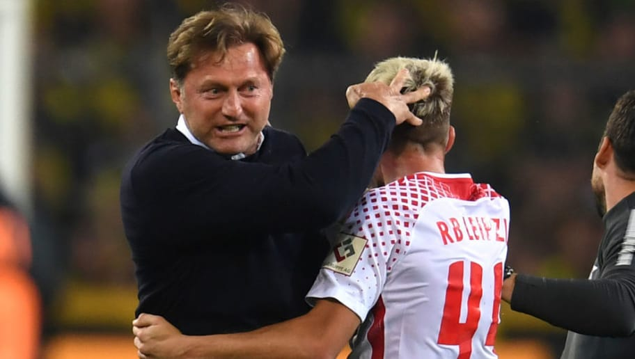 Leipzig's headcoach Ralph Hasenhuettl (L) hugs Leipzig's Slovanian midfielder Kevin Kampl after Leipzig won the German First division Bundesliga football match Borussia Dortmund vs RB Leipzig in Dortmund, western Germany, on October 14, 2017. / AFP PHOTO / PATRIK STOLLARZ / RESTRICTIONS: DURING MATCH TIME: DFL RULES TO LIMIT THE ONLINE USAGE TO 15 PICTURES PER MATCH AND FORBID IMAGE SEQUENCES TO SIMULATE VIDEO. == RESTRICTED TO EDITORIAL USE == FOR FURTHER QUERIES PLEASE CONTACT DFL DIRECTLY AT + 49 69 650050         (Photo credit should read PATRIK STOLLARZ/AFP/Getty Images)