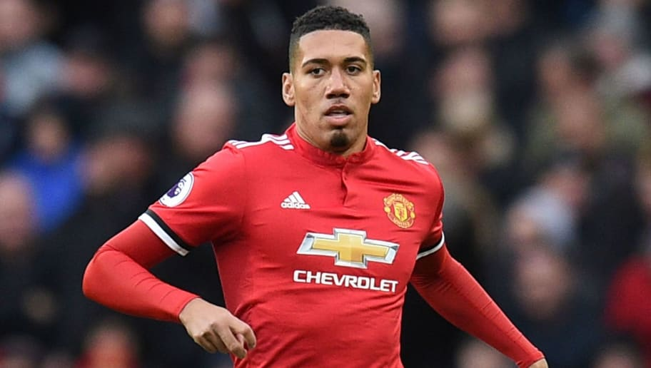 Manchester United's English defender Chris Smalling controls the ball during the English Premier League football match between Manchester United and Brighton and Hove Albion at Old Trafford in Manchester, north west England, on November 25, 2017. / AFP PHOTO / Oli SCARFF / RESTRICTED TO EDITORIAL USE. No use with unauthorized audio, video, data, fixture lists, club/league logos or 'live' services. Online in-match use limited to 75 images, no video emulation. No use in betting, games or single club/league/player publications.  /         (Photo credit should read OLI SCARFF/AFP/Getty Images)