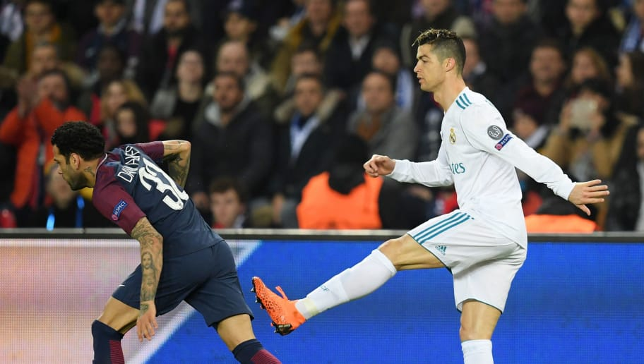 PARIS, FRANCE - MARCH 06:  Cristiano Ronaldo of Real Madrid aims a kick at Dani Alves of PSG during the UEFA Champions League Round of 16 Second Leg match between Paris Saint-Germain and Real Madrid at Parc des Princes on March 6, 2018 in Paris, France.  (Photo by Matthias Hangst/Getty Images)