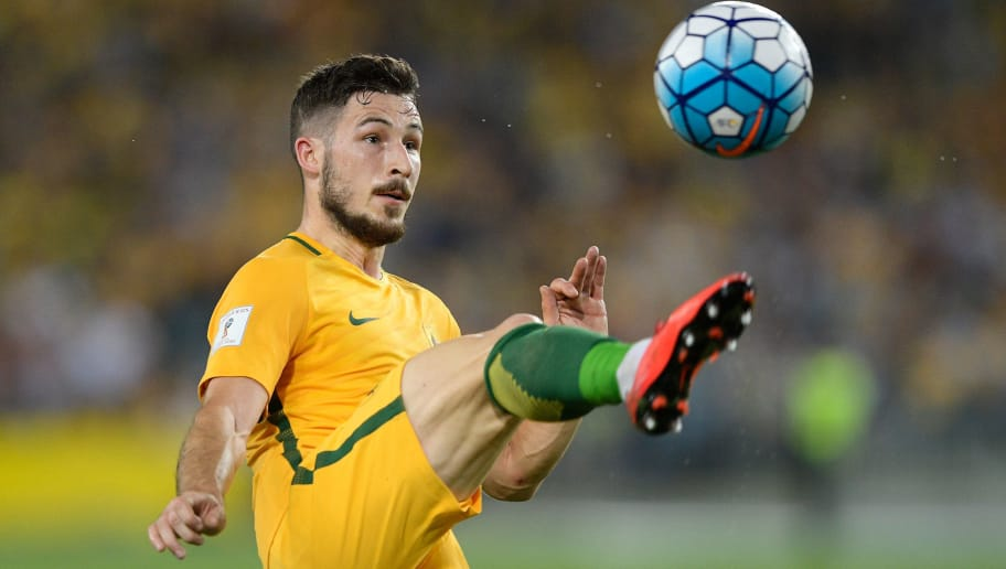 SYDNEY, AUSTRALIA - NOVEMBER 15: Mathew Leckie of Australia controls the ball during the 2018 FIFA World Cup Qualifiers Leg 2 match between the Australian Socceroos and Honduras at ANZ Stadium on November 15, 2017 in Sydney, Australia.  (Photo by Brett Hemmings/Getty Images)