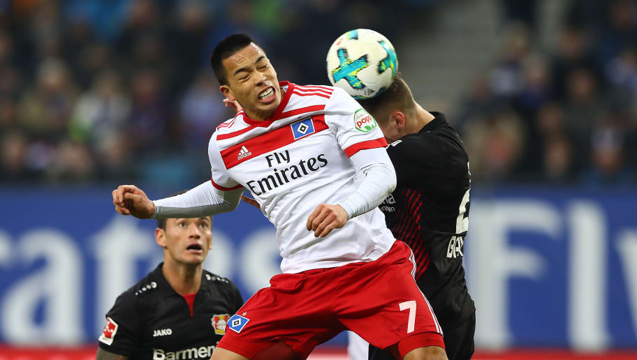 HAMBURG, GERMANY - FEBRUARY 17: Bobby Wood of Hamburg (l) fights for the ball with Dominik Kohr of Bayer Leverkusen during the Bundesliga match between Hamburger SV and Bayer 04 Leverkusen at Volksparkstadion on February 17, 2018 in Hamburg, Germany. (Photo by Martin Rose/Bongarts/Getty Images)