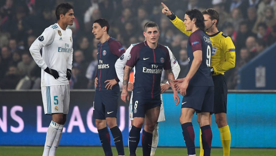 Paris Saint-Germain's Italian midfielder Marco Verratti (C) reacts as he receives a red for two yellow cards from German referee Felix Brych (R)  during the UEFA Champions League round of 16 second leg football match between Paris Saint-Germain (PSG) and Real Madrid on March 6, 2018, at the Parc des Princes stadium in Paris. / AFP PHOTO / PIERRE-PHILIPPE MARCOU        (Photo credit should read PIERRE-PHILIPPE MARCOU/AFP/Getty Images)