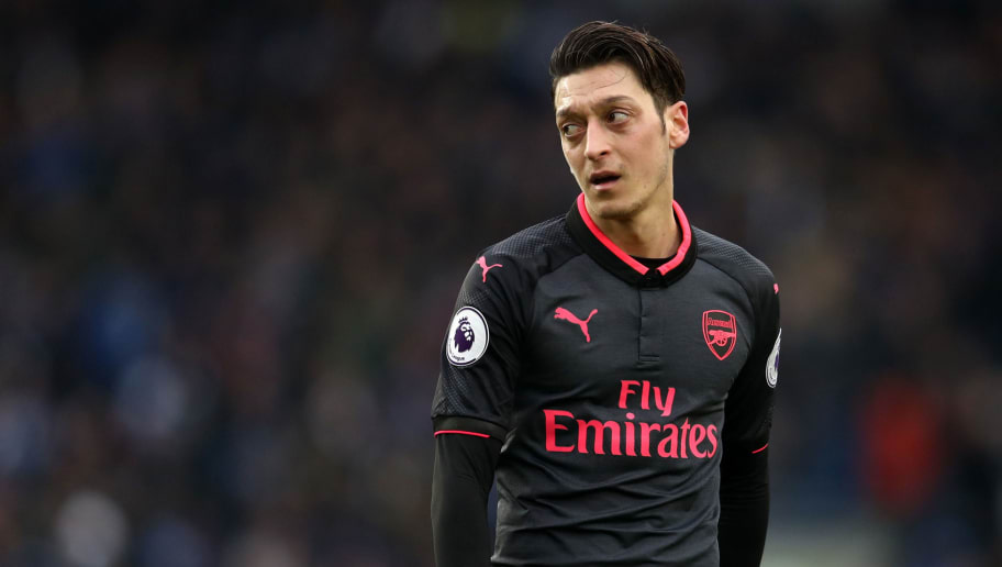 BRIGHTON, ENGLAND - MARCH 04: Mesut Ozil of Arsenal during the Premier League match between Brighton and Hove Albion and Arsenal at Amex Stadium on March 4, 2018 in Brighton, England. (Photo by Catherine Ivill/Getty Images)