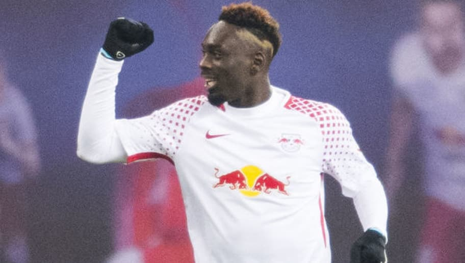 Leipzig´s French forward Jean-Kevin Augustin celebrates scoring during the German first division Bundesliga football match RB Leipzig vs Borussia Dortmund in Leipzig, eastern Germany, on March 3, 2018. / AFP PHOTO / ROBERT MICHAEL / RESTRICTIONS: DURING MATCH TIME: DFL RULES TO LIMIT THE ONLINE USAGE TO 15 PICTURES PER MATCH AND FORBID IMAGE SEQUENCES TO SIMULATE VIDEO. == RESTRICTED TO EDITORIAL USE == FOR FURTHER QUERIES PLEASE CONTACT DFL DIRECTLY AT + 49 69 650050         (Photo credit should read ROBERT MICHAEL/AFP/Getty Images)