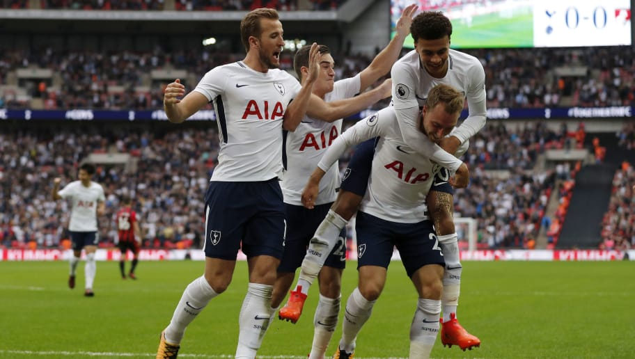 Tottenham Hotspur's Danish midfielder Christian Eriksen (R) celebrates with Tottenham Hotspur's English midfielder Dele Alli (2R), Tottenham Hotspur's English midfielder Harry Winks (2L) and Tottenham Hotspur's English striker Harry Kane (L), scoring the team's first goal during the English Premier League football match between Tottenham Hotspur and Bournemouth at Wembley Stadium in London, on October 14, 2017. / AFP PHOTO / Adrian DENNIS / RESTRICTED TO EDITORIAL USE. No use with unauthorized audio, video, data, fixture lists, club/league logos or 'live' services. Online in-match use limited to 75 images, no video emulation. No use in betting, games or single club/league/player publications.  /         (Photo credit should read ADRIAN DENNIS/AFP/Getty Images)