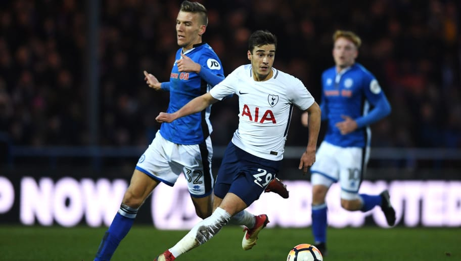 ROCHDALE, ENGLAND - FEBRUARY 18:  Harry Winks of Tottenham Hotspur and Mark Kitching of Rochdale AFC in action during The Emirates FA Cup Fifth Round match between Rochdale and Tottenham Hotspur on February 18, 2018 in Rochdale, United Kingdom.  (Photo by Gareth Copley/Getty Images)