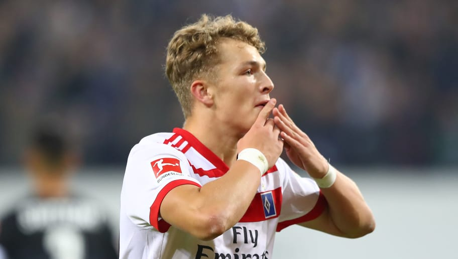HAMBURG, GERMANY - NOVEMBER 04: Jann-Fiete Arp of Hamburg celebrates after he scored a goal to make it 3:1 during the Bundesliga match between Hamburger SV and VfB Stuttgart at Volksparkstadion on November 4, 2017 in Hamburg, Germany. (Photo by Martin Rose/Bongarts/Getty Images)