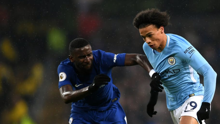 MANCHESTER, ENGLAND - MARCH 04: Antonio Rudiger of Chelsea and Leroy Sane of Manchester City battle for the ball during the Premier League match between Manchester City and Chelsea at Etihad Stadium on March 4, 2018 in Manchester, England.  (Photo by Laurence Griffiths/Getty Images)