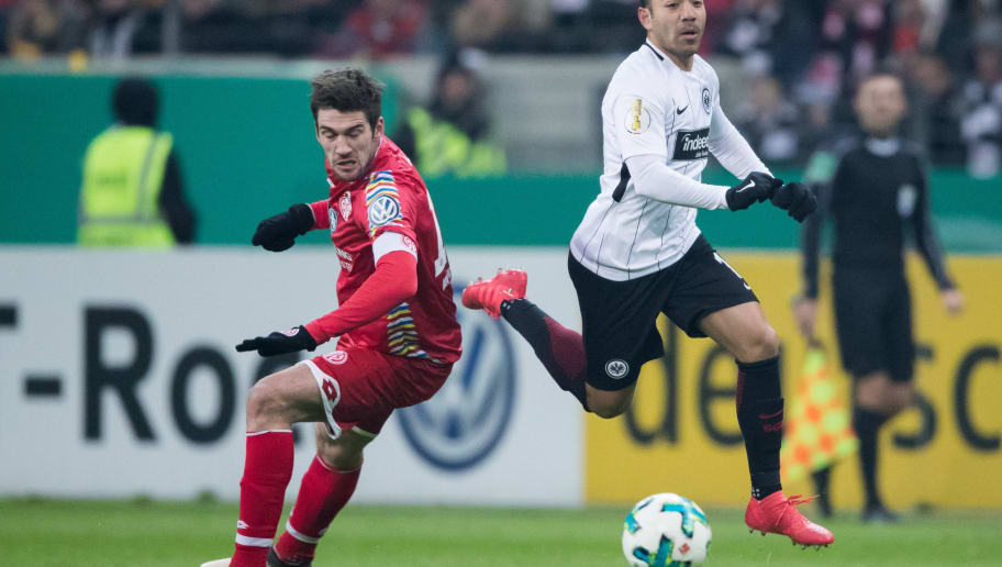 FRANKFURT AM MAIN, GERMANY - FEBRUARY 07: Marco Fabian of Frankfurt is challenged by Stefan Bell of Mainz during the DFB Cup quarter final match between Eintracht Frankfurt and 1. FSV Mainz 05 at Commerzbank-Arena on February 7, 2018 in Frankfurt am Main, Germany. (Photo by Simon Hofmann/Bongarts/Getty Images)