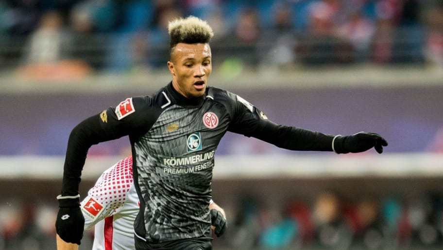 Mainz´ Ivorian midfielder Jean-Philippe Gbamin plays the ball during the German first division Bundesliga football match between RB Leipzig and Mainz 05 in Leipzig, eastern Germany on December 9, 2017.  / AFP PHOTO / ROBERT MICHAEL / RESTRICTIONS: DURING MATCH TIME: DFL RULES TO LIMIT THE ONLINE USAGE TO 15 PICTURES PER MATCH AND FORBID IMAGE SEQUENCES TO SIMULATE VIDEO. == RESTRICTED TO EDITORIAL USE == FOR FURTHER QUERIES PLEASE CONTACT DFL DIRECTLY AT + 49 69 650050         (Photo credit should read ROBERT MICHAEL/AFP/Getty Images)