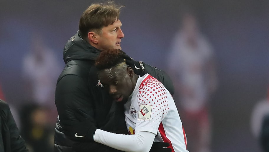 LEIPZIG, GERMANY - MARCH 03: Jean-Kevin Augustin of Leipzig is huge by coach Ralph Hasenhuettl of Leipzig as he is being substituted and comes of, during the Bundesliga match between RB Leipzig and Borussia Dortmund at Red Bull Arena on March 3, 2018 in Leipzig, Germany. (Photo by Boris Streubel/Bongarts/Getty Images)
