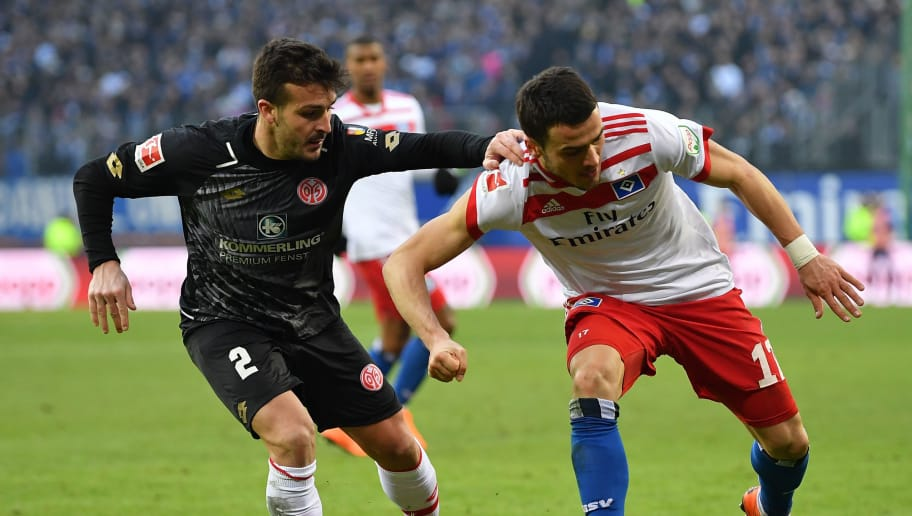 HAMBURG, GERMANY - MARCH 03:  Filip Kostic of Hamburg is challenged by Giulio Donati of Mainz during the Bundesliga match between Hamburger SV and 1. FSV Mainz 05 at Volksparkstadion on March 3, 2018 in Hamburg, Germany.  (Photo by Stuart Franklin/Bongarts/Getty Images)