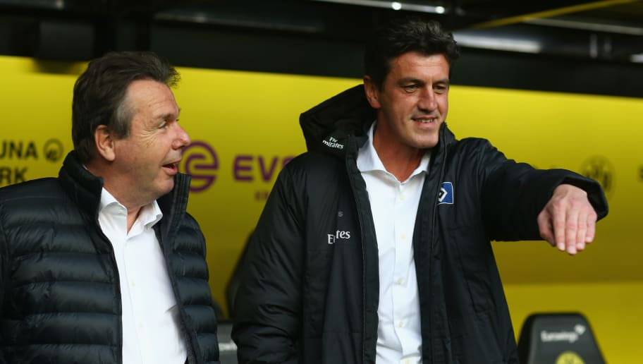 DORTMUND, GERMANY - APRIL 04:  (L-R) Chairman of the board heribert Bruchhagen and sporting director Jens Todt of Hamburg look on prior to the Bundesliga match between Borussia Dortmund and Hamburger SV at Signal Iduna Park on April 4, 2017 in Dortmund, Germany.  (Photo by Christof Koepsel/Bongarts/Getty Images)