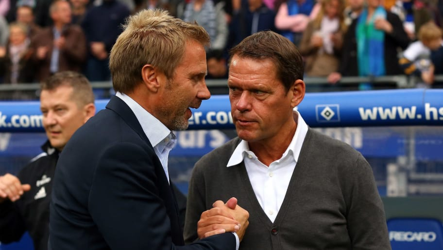 HAMBURG, GERMANY - OCTOBER 21:  Thorsten Fink, head coach of Hamburg shake hands with sport director Frank Arnesen before the Bundesliga match between Hamburger SV and VfB Stuttgart at Imtech Arena on October 21, 2012 in Hamburg, Germany.  (Photo by Martin Rose/Bongarts/Getty Images)