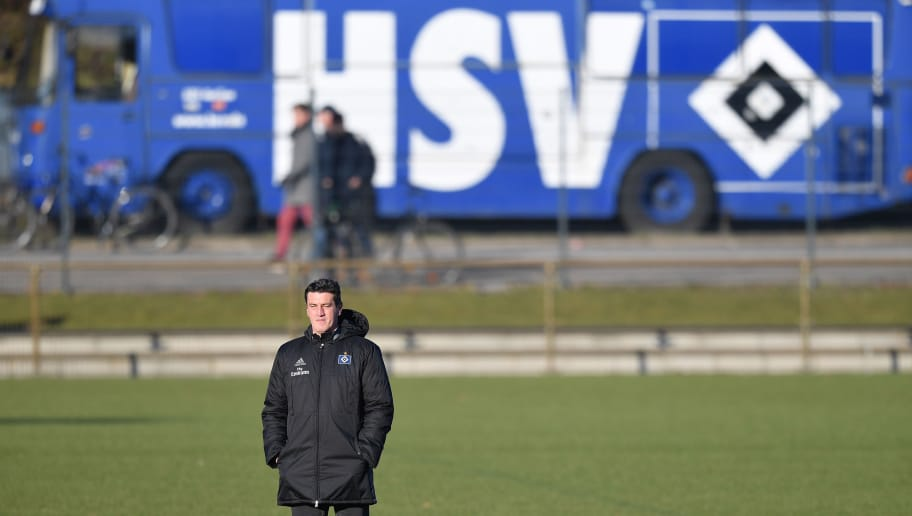 HAMBURG, GERMANY - FEBRUARY 14:  Jens Todt, sports director of Hamburg looks on during a training session of Hamburger SV at Volksparkstadion on February 14, 2018 in Hamburg, Germany.  (Photo by Stuart Franklin/Bongarts/Getty Images)