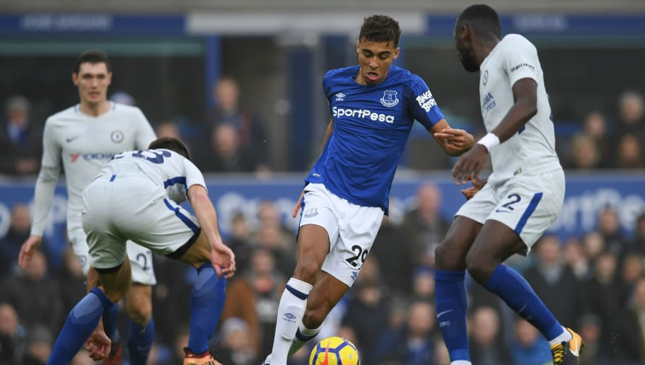 Everton's English striker Dominic Calvert-Lewin (C) runs through and takes on Chelsea's Spanish defender Cesar Azpilicueta (L) and Chelsea's German defender Antonio Rudiger (R) during the English Premier League football match between Everton and Chelsea at Goodison Park in Liverpool, north west England on December 23, 2017. / AFP PHOTO / Paul ELLIS / RESTRICTED TO EDITORIAL USE. No use with unauthorized audio, video, data, fixture lists, club/league logos or 'live' services. Online in-match use limited to 75 images, no video emulation. No use in betting, games or single club/league/player publications.  /         (Photo credit should read PAUL ELLIS/AFP/Getty Images)