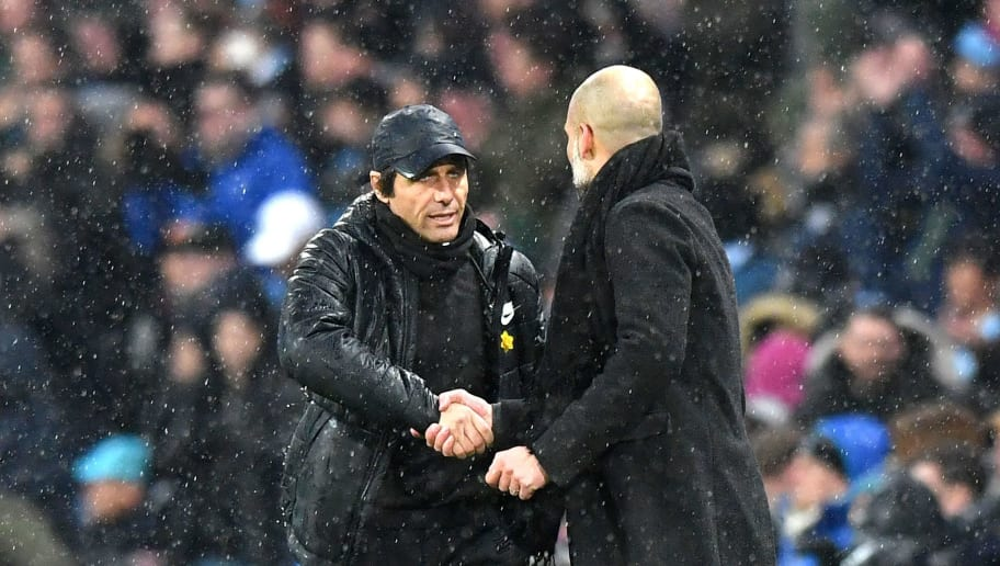 Chelsea's Italian head coach Antonio Conte (L) and Manchester City's Spanish manager Pep Guardiola shake hands after during the English Premier League football match between Manchester City and Chelsea at the Etihad Stadium in Manchester, north west England on March 4, 2018. / AFP PHOTO / Anthony Devlin / RESTRICTED TO EDITORIAL USE. No use with unauthorized audio, video, data, fixture lists, club/league logos or 'live' services. Online in-match use limited to 75 images, no video emulation. No use in betting, games or single club/league/player publications.  /         (Photo credit should read ANTHONY DEVLIN/AFP/Getty Images)