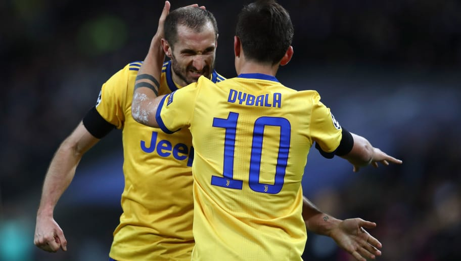LONDON, ENGLAND - MARCH 07: Giorgio Chiellini of Juventus celebrates with Paulo Dybala of Juventus during the UEFA Champions League Round of 16 Second Leg match between Tottenham Hotspur and Juventus at Wembley Stadium on March 7, 2018 in London, United Kingdom. (Photo by Catherine Ivill/Getty Images)