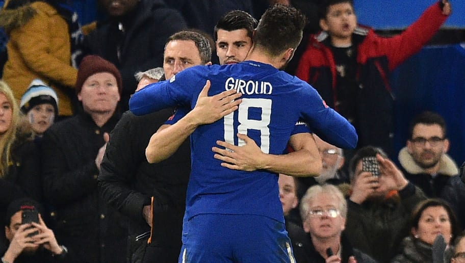 Chelsea's Spanish striker Alvaro Morata (L) greets Chelsea's French attacker Olivier Giroud on his substitution during the English FA Cup fifth round football match between Chelsea and Hull City at Stamford Bridge in London on February 16, 2018. / AFP PHOTO / Glyn KIRK / RESTRICTED TO EDITORIAL USE. No use with unauthorized audio, video, data, fixture lists, club/league logos or 'live' services. Online in-match use limited to 75 images, no video emulation. No use in betting, games or single club/league/player publications.  /         (Photo credit should read GLYN KIRK/AFP/Getty Images)
