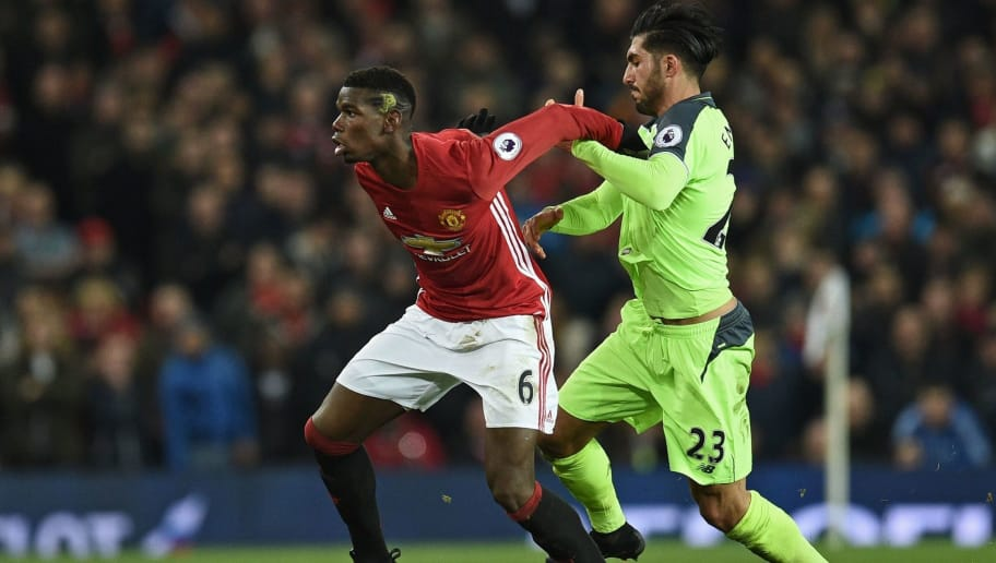 Liverpool's German midfielder Emre Can (R) vies with Manchester United's French midfielder Paul Pogba during the English Premier League football match between Manchester United and Liverpool at Old Trafford in Manchester, north west England, on January 15, 2017. / AFP / Oli SCARFF / RESTRICTED TO EDITORIAL USE. No use with unauthorized audio, video, data, fixture lists, club/league logos or 'live' services. Online in-match use limited to 75 images, no video emulation. No use in betting, games or single club/league/player publications.  /         (Photo credit should read OLI SCARFF/AFP/Getty Images)
