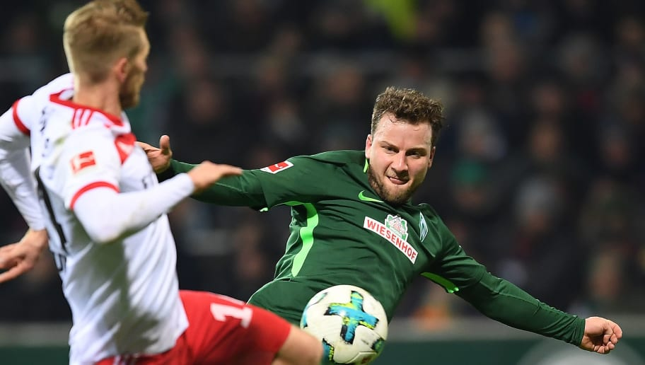 BREMEN, GERMANY - FEBRUARY 24: Philipp Bargfrede of Bremen (r) fights for the ball with Aaron Hunt of Hamburg during the Bundesliga match between SV Werder Bremen and Hamburger SV at Weserstadion on February 24, 2018 in Bremen, Germany. (Photo by Lukas Schulze/Bongarts/Getty Images)