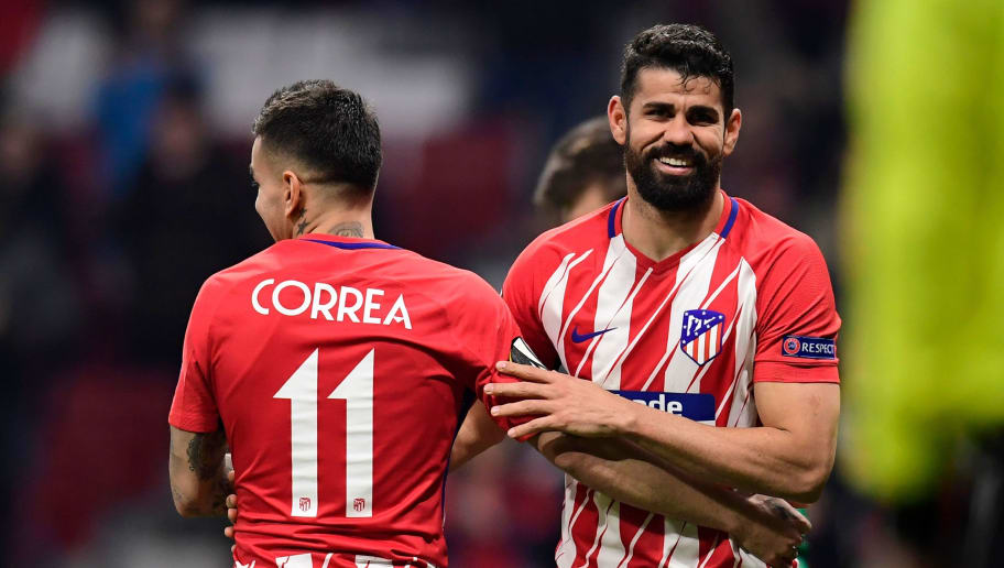Atletico Madrid's Spanish forward Diego Costa (R) celebrates with Atletico Madrid's Argentinian forward Angel Correa after scoring during the Europa League Round of 16 first leg football match between Club Atletico de Madrid and FC Lokomotiv Moscow at the Wanda Metropolitano stadium in Madrid on March 8, 2018. / AFP PHOTO / JAVIER SORIANO        (Photo credit should read JAVIER SORIANO/AFP/Getty Images)