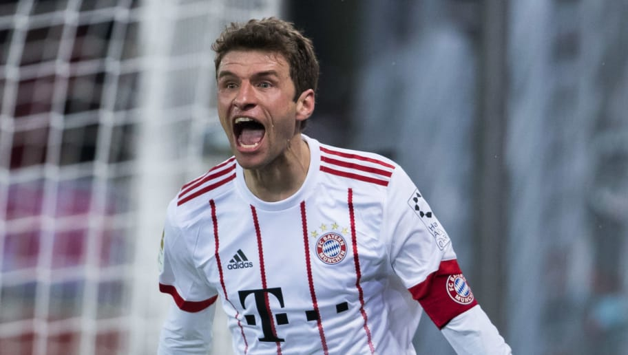 FREIBURG IM BREISGAU, GERMANY - MARCH 04: Thomas Mueller of Muenchen celebrates his team's fourth goal during the Bundesliga match between Sport-Club Freiburg and FC Bayern Muenchen at Schwarzwald-Stadion on March 4, 2018 in Freiburg im Breisgau, Germany. (Photo by Simon Hofmann/Bongarts/Getty Images)