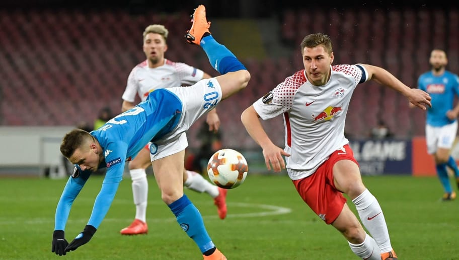 Napoli's Polish midfielder Piotr Zielinski (L) vies for the ball with Leipzig's German defender Willi Orban during the UEFA Europa League football match between Napoli and Leipzig, on February 15, 2018 at San Paolo stadium in Naples.  / AFP PHOTO / Andreas SOLARO        (Photo credit should read ANDREAS SOLARO/AFP/Getty Images)