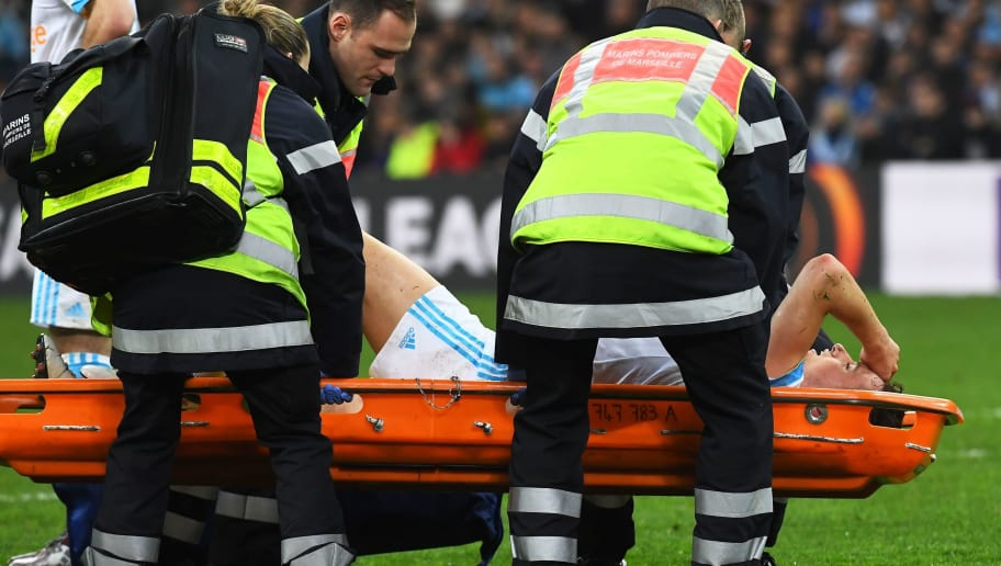 Olympique de Marseille's French midfielder Florian Thauvin leaves on a stretcher after being injured during the UEFA Europa League football match between Marseille and Atletic Bilbao on March 8, 2018 at the 'Velodrome' stadium in Marseille, southern France. / AFP PHOTO / ANNE-CHRISTINE POUJOULAT        (Photo credit should read ANNE-CHRISTINE POUJOULAT/AFP/Getty Images)