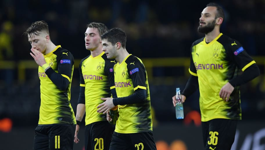 DORTMUND, GERMANY - MARCH 08:  Marco Reus, Maximilian Philipp, Christian Pulisic and Omer Toprak of Borussia Dortmund look dejected in defeat after the UEFA Europa League Round of 16 match between Borussia Dortmund and FC Red Bull Salzburg at the Signal Iduna Park on March 8, 2018 in Dortmund, Germany.  (Photo by Stuart Franklin/Bongarts/Getty Images)