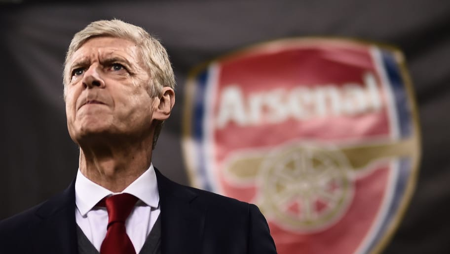 TOPSHOT - Arsenal's coach Arsene Wenger from France looks on during the UEFA Europa League round of 16 first-leg football match AC Milan Vs Arsenal at the 'San Siro Stadium' in Milan on March 8, 2018. / AFP PHOTO / MARCO BERTORELLO        (Photo credit should read MARCO BERTORELLO/AFP/Getty Images)