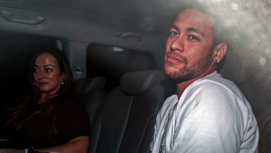 TOPSHOT - Brazilian superstar Neymar (R), is pictured next to his mother Nadine Goncalves Da Silva upon their arrival in Belo Horizonte, Minas Gerais state, Brazil on March 2, 2018 ahead of an operation on his fractured foot.  Brazilian superstar Neymar arrived in Belo Horizonte later Friday for surgery to mend a broken bone in his right foot, while an anxious footballing nation wondered if its World Cup build-up will also need urgent care. / AFP PHOTO / NELSON ALMEIDA        (Photo credit should read NELSON ALMEIDA/AFP/Getty Images)