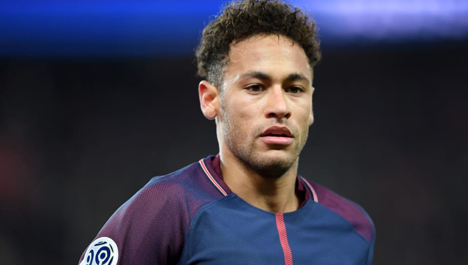 Paris Saint-Germain's Brazilian forward Neymar Jr looks on during the French Ligue 1 football match between Paris Saint-Germain (PSG) and Strasbourg at The Parc des Princes in Paris on February 17, 2018.  / AFP PHOTO / CHRISTOPHE ARCHAMBAULT        (Photo credit should read CHRISTOPHE ARCHAMBAULT/AFP/Getty Images)