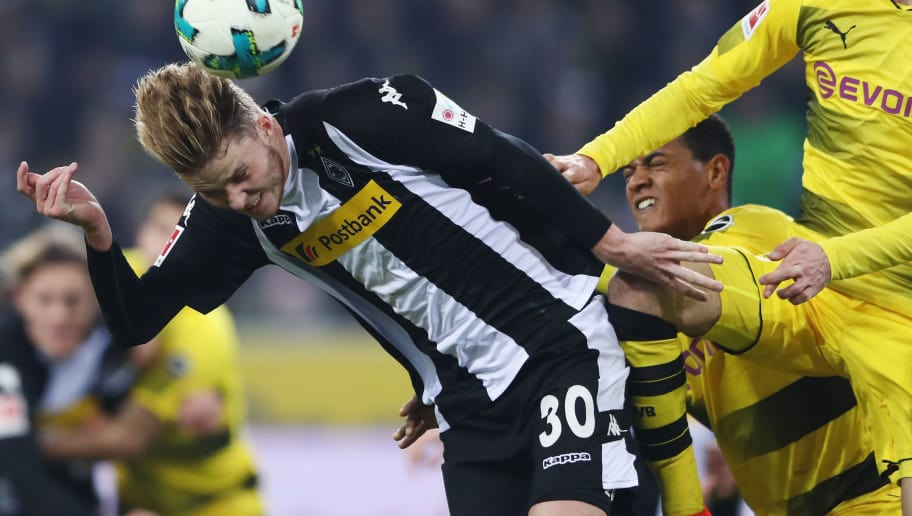 MOENCHENGLADBACH, GERMANY - FEBRUARY 18: Nico Elvedi (L) of Moenchengladbach is challenged by Julian Weigl of Dortmund during the Bundesliga match between Borussia Moenchengladbach and Borussia Dortmund at Borussia-Park on February 18, 2018 in Moenchengladbach, Germany.  (Photo by Alex Grimm/Bongarts/Getty Images)