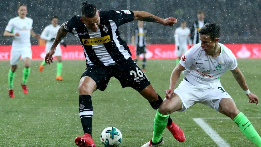 MOENCHENGLADBACH, GERMANY - MARCH 02: Marco Friedl of Bremen (R) challenges Raul Bobadilla of Moenchengladbach (L) during the Bundesliga match between Borussia Moenchengladbach and SV Werder Bremen at Borussia-Park on March 2, 2018 in Moenchengladbach, Germany. (Photo by Christof Koepsel/Bongarts/Getty Images)