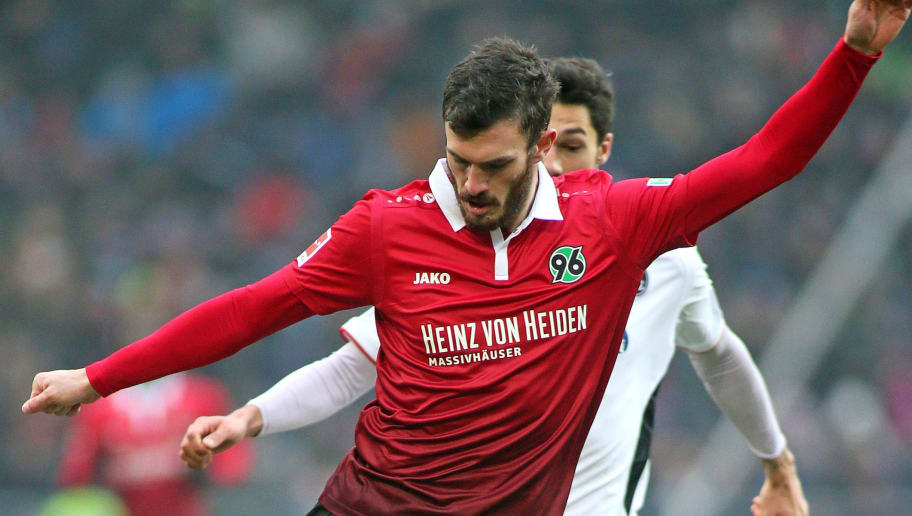 HANOVER, GERMANY - FEBRUARY 10: Josip Elez of Hannover 96 fights for the ball with Tim Kleindienst of SC Freiburg during the Bundesliga match between Hannover 96 and Sport-Club Freiburg at HDI-Arena on February 10, 2018 in Hanover, Germany. (Photo by Selim Sudheimer/Bongarts/Getty Images)
