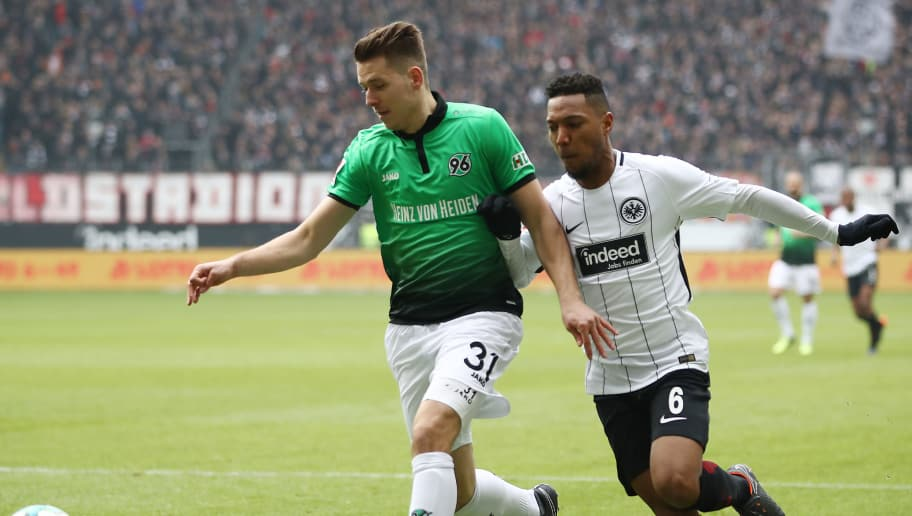 FRANKFURT AM MAIN, GERMANY - MARCH 03: Waldemar Anton of Hannover (l) is chased by Jonathan de Guzman of Frankfurt during the Bundesliga match between Eintracht Frankfurt and Hannover 96 at Commerzbank-Arena on March 3, 2018 in Frankfurt am Main, Germany. (Photo by Maja Hitij/Bongarts/Getty Images)