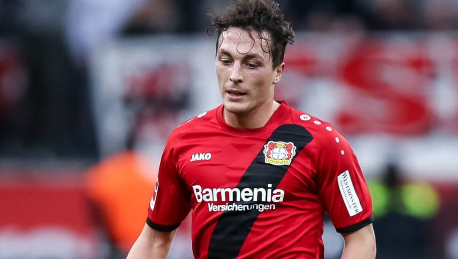 LEVERKUSEN, GERMANY - JANUARY 28: Julian Baumgartlinger #15 of Bayer Leverkusen controls the ball during the Bundesliga match between Bayer 04 Leverkusen and 1. FSV Mainz 05 at BayArena on January 28, 2018 in Leverkusen, Germany. (Photo by Maja Hitij/Bongarts/Getty Images)