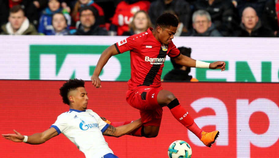 LEVERKUSEN, GERMANY - FEBRUARY 25: (L-R) Thilo Kehrer of Schalke challenges Leon Bailey of Leverkusen during the Bundesliga match between Bayer 04 Leverkusen and FC Schalke 04 at BayArena on February 25, 2018 in Leverkusen, Germany. (Photo by Christof Koepsel/Bongarts/Getty Images)