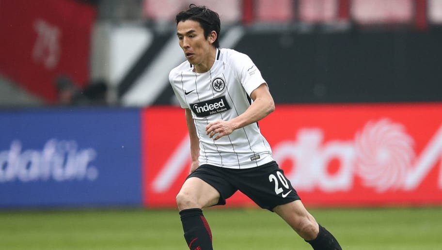 FRANKFURT AM MAIN, GERMANY - MARCH 03: Makoto Hasebe #20 of Eintracht Frankfurt controls the ball during the Bundesliga match between Eintracht Frankfurt and Hannover 96 at Commerzbank-Arena on March 3, 2018 in Frankfurt am Main, Germany. (Photo by Maja Hitij/Bongarts/Getty Images)