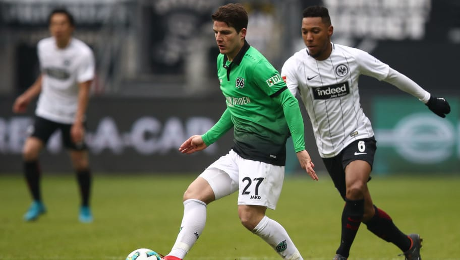 FRANKFURT AM MAIN, GERMANY - MARCH 03: Pirmin Schwegler #27 of Hannover 96 and Jonathan de Guzman #6 of Eintracht Frankfurt battle for the ball during the Bundesliga match between Eintracht Frankfurt and Hannover 96 at Commerzbank-Arena on March 3, 2018 in Frankfurt am Main, Germany. (Photo by Maja Hitij/Bongarts/Getty Images)