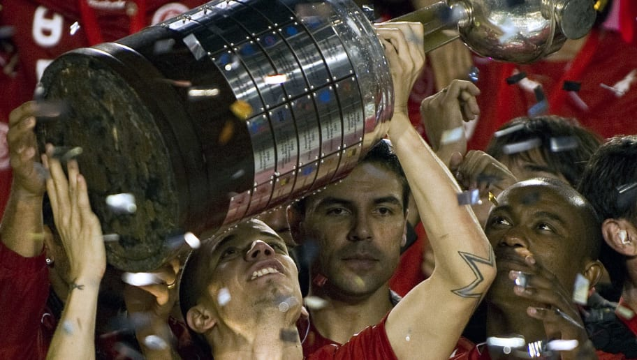 Argentine player of Brazil's Internacional, forward Andres D'Alessandro (L), holds up the Libertadores Cup on August 18, 2010 at Beira Rio stadium in Porto Alegre, Brazil. Internacional defeated Mexican Chivas by 3-2. AFP PHOTO / ANTONIO SCORZA (Photo credit should read ANTONIO SCORZA/AFP/Getty Images)