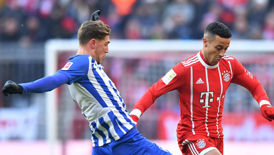 MUNICH, GERMANY - FEBRUARY 24: Niklas Stark of Berlin (l9 fights for the ball with Thiago Alcantara of Bayern Muenchen during the Bundesliga match between FC Bayern Muenchen and Hertha BSC at Allianz Arena on February 24, 2018 in Munich, Germany. (Photo by Sebastian Widmann/Bongarts/Getty Images)