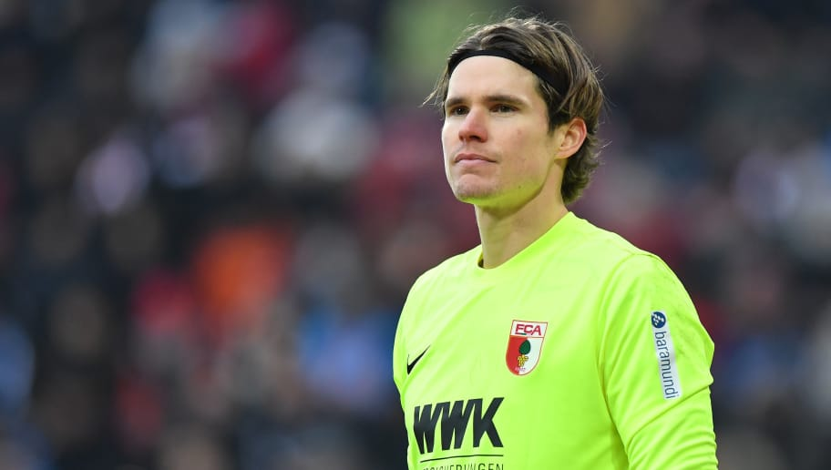 AUGSBURG, GERMANY - FEBRUARY 18: Goalkeeper Marwin Hitz of Augsburg looks on during the Bundesliga match between FC Augsburg and VfB Stuttgart at WWK-Arena on February 18, 2018 in Augsburg, Germany. (Photo by Sebastian Widmann/Bongarts/Getty Images)
